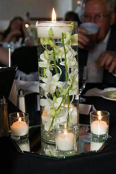 Centro sumergible con orquideas y velas