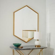 another cool mirror - like this little entry mirror/table idea for the space by front door...  Metal Hexagon Framed Mirror - Antique Brass | West Elm