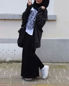Street style hijab- black skirt with slit and white sneakers