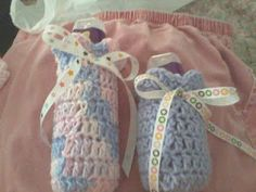 crochet baby bottle covers from pattern for nappy cake