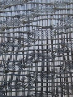 Detail, woven tape art by Australian artist Laura Labrin. Stretched VHS tape. via Roseanne Broadley
