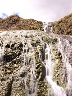 A set of waterfalls fuelled by glacial rivers running through the Lares Valley Peru.