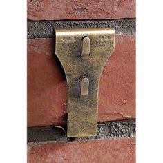 """Brick Clip Fasteners"" - solution for attaching pictures, clocks, climbing vines, or seasonal decorations to brick, indoors or out, without drilling damaging holes. Clips snap easily onto any standard 2 1⁄8"" to 2 1⁄2"" high brick with a minimum of 1⁄8"" mortar recess. When its time to redecorate, just unclip and reuse. Durable, rust-resistant steel with an antiqued brass finish; each holds up to 25 lbs. Package of 8. $20.00"