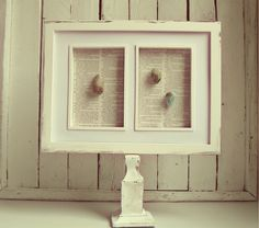 Love this frame made with a candlestick attached to a frame