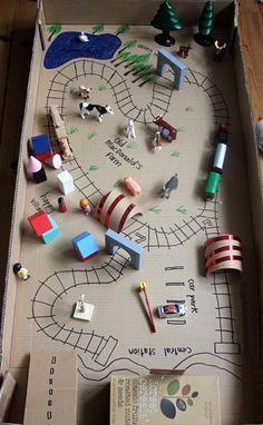 Из большой коробки можно соорудить городок с дорогами и домиками, где малыш сможет играть.