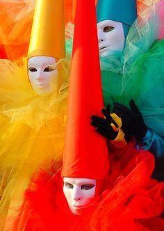 Carnevale di Venezia, Italia  (I like something about the pale face with no other features showing...eerie. The hat could be anything, even a wig. I think that tulle stuff can be found at most craft stores...in most colors too...)