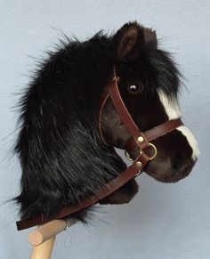 Hobby horse, stick horse, Dark Bay plush. Top quality with hardwood pole, handle and wheels and removable leather bridle with bell. by AdorablePonies on Etsy https://www.etsy.com/listing/158009133/hobby-horse-stick-horse-dark-bay-plush