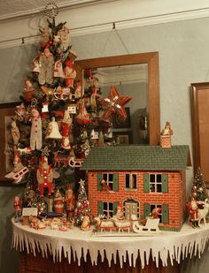 Old Dollhouse...icicle border on the tablecloth...vintage ornaments on the tree.