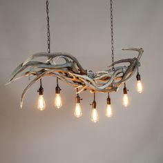 peakantlers.com Using Axis Deer shed antlers in a new more mountain modern antler chandelier design. The axis deer have a unique natural curve that inspired this rushing wave looking design. It a soft gray wash keep the natural beauty of the antlers yet adds a modern finish to create a new antler chandelier style. Edison light bulbs used with black electrical components. #antlers #antlerchandelier #thepeakantlercompany #antler #interiordesign #antlerdecor #antlerlighting #mountainmodern