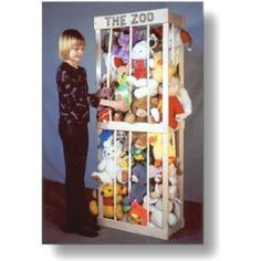 Stuffed Animal Storage- Simple frame with bungee cords. Animals contained but still accessible by kids.
