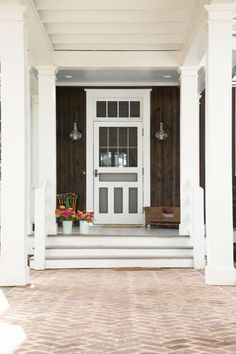 screen door + herringbone brick path