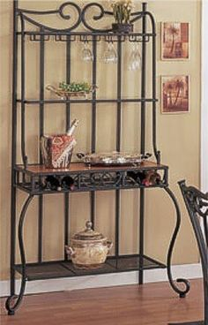 "$427.94 Metal & Wood Baker's Kitchen Rack w/Wine Storage - Metal & Wood Baker's Kitchen Rack w/Wine Storage This is a brand new metal and wood baker's kitchen rack with glass hangers and a built in wine rack storage area. Item will make a great addition to your home decor furniture setting. Item may require some simple assembly. Dimensions Measure: 34""W 18""D 72""H http://www.amazon.com/dp/B000G0SVI2/?tag=pin2wine-20"