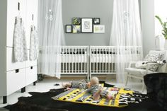 Side-by-side cribs with a black and white palette in a twin nursery look ultra contemporary. Throw in some bright pops of yellow to liven things up.