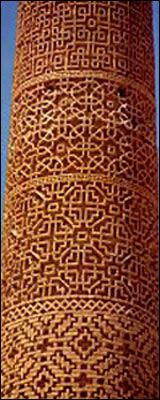 Seljuk minaret of the mosque  at Damqan, Iran. The decorative effect achieved by the use of recessed bricks, forming highly original rhythms and geometric patterns, is characteristic  of this 11th century Persian art.