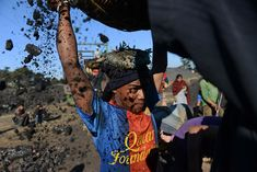 A young worker places a basket filled with coal on his head at a roadside coal depot in the Indian northeastern state of Meghalaya. (AFP)