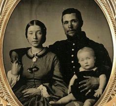 Such a sweet family picture. I wonder if he made it home from the war.....