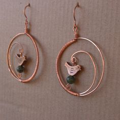 Spiral hoop handmade bird earrings, copper and green agate. $24.00, via Etsy.