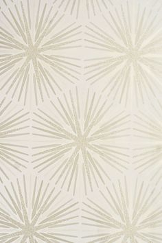 Spark Wallpaper Sunburst design wallpaper in light taupe and cream with cracked glaze textured effect.