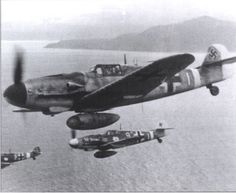 """Three Bf-109G 6's head toward their base in Greece.  The nearest plane is an unmodified version, but the other two have tropical filters and underwing gondolas to hold MG 151/20 cannons.  The modified version was nicknamed """"Kanonenboote"""", or gunboat."""