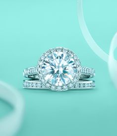 Tiffany Embrace® diamond engagement ring with a channel-set diamond band ring. #TiffanyPinterest #WeddingBand