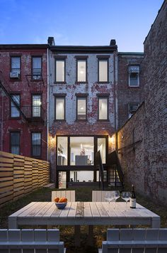 """Leone Design Studio transformed James Darrow and Monica Folch's three-unit apartment building in Park Slope sandwiched between two other buildings into a luminous single family home. Photo by . Townhouse Exterior, Modern Townhouse, Townhouse Designs, Building Design, House Tours, Town House, Decoration, Modern Architecture, Interior And Exterior"