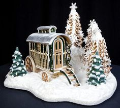 Gingerbread vardo!  I wish the picture were larger so I could see more of the details.  Also love the curly, stylized trees in the background.