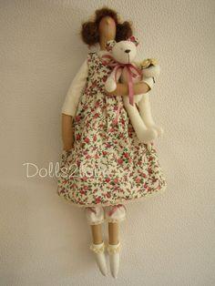 Tilda doll Ashley wearing a pink liberty fabric by Dolls2love