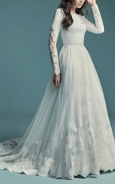 Maggie Sottero - OLYSSIA, This elegant sleeved wedding dress is comprised of Talin Stretch Crepe. Featuring a bateau neckline, scoop back, and lace illusion along the long sleeves. #MaggieSottero #Maggiebride #mylovestory #weddingdress