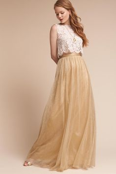 Dreamy, floor-skimming tulle is a great base for an original bridesmaid look. We recommend pairing it with the Cleo Top. Only available at BHLDN Pictured with Cleo Top Bridesmaid Skirt And Top, Bridesmaid Dress Colors, Long Bridesmaid Dresses, Bridesmaids, Tulle Skirts, Tulle Dress, Long Gold Skirt, Champaign Wedding Dress, Gold Tulle