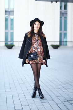 <3 Outfit: Patterned shirt and skirt plus all black coat and accessories