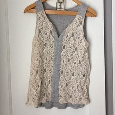Lace tank Super fun lace tank!! Bought through stitch fix haven't worn much. Need to wear a cami underneath. Size large fits snug but not to tight Mystree Tops Tank Tops