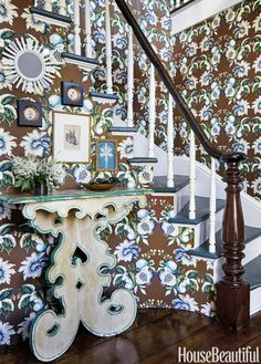 The stair hall is sheathed in an Oscar de la Renta wallpaper from Lee Jofa; Maxwell Foster and her partner Suysel dePedro Cunningham found the dramatic Italian table at Nickey Kehoe in Los Angeles.