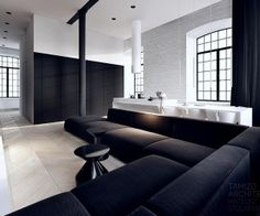 This black and white interior vision is a striking loft in the complex 'Scheibler' in Lodz, with a useable area of 64 m2. White washed brick...