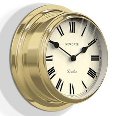 Newgate+Ocean+Wall+Clock+-+Brass+-+Ahoy+there!+Bring+a+touch+of+the+ocean's+treasure+into+your+home+with+this+stunning+metal+ship+clock+from+Newgate+Clocks! The+Newgate+Ocean+Wall+Clock+-+Brass+is+a+real+gem+of+a+timepiece,+which+will+have+your+dreaming+of+sailing+the+open+ocean.+With+a+sleek+brass+finish,+this+classic+ship+clock+is+perfect+for+boat+and+sailing+lovers.+Boasting+a+deep+metal+case+with+a+flat+glass+lense+and+roman+numerals+on+its+face,+this+wonderful+wall+clock+will+ins...