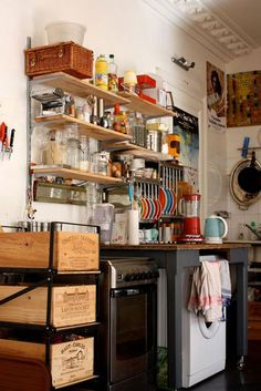 Love the wine box storage system in Gabriel Wick and Olivier's Paris kitchen.