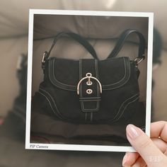 Coach black handbag purse Authentic Coach black with white stitching. Gently used. Hangtag. Comes with sleeper bag. Coach Bags Shoulder Bags