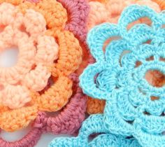 Crochet flower patterns are so versatile, and this 9 Petal Crochet Flower Pattern capitalizes on this by offering an easy crochet pattern for you to duplicate, mix and match, and enjoy. These flower motifs can decorate scrapbooks or hair accessories. All Free Crochet, Diy Crochet, Crochet Crafts, Crochet Hooks, Crochet Things, Crochet Ideas, Crochet Flower Patterns, Crochet Motif, Crochet Flowers