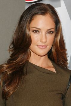 Minka Kelly chocolate brown long curly hair with amber and golden highlights.