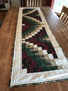 This beautiful table runner is made of lovely Christmas colored and patterned fabrics. Each piece is stitched together to form a unique pattern that will look Quilted Table Runners Christmas, Patchwork Table Runner, Christmas Runner, Table Runner And Placemats, Table Runner Pattern, Christmas Quilting, Colchas Quilt, Bargello Quilts, Modern Table Runners