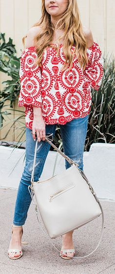 Get fine in vine! With a passionate red vine print and off-shoulder detail, this billowy top is spring style goals. Passion in Vine Embroidered Off-shoulder Top in Red featured by Champagnelifestyleblog/ hannahhagler
