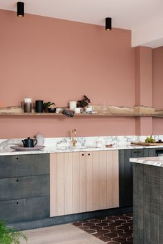 Rough sawn English beech cupboards, Arabescato marble worktops, soft terracotta walls and a beautifully rustic Cheshire Oak shelf
