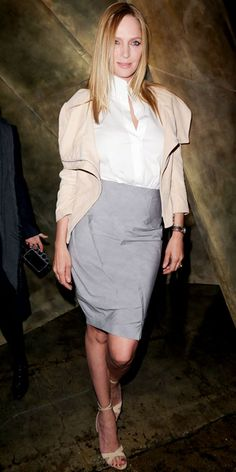 Uma Thurman in cropped jacket and knee-length pencil skirt at the Donna Karan fashion show