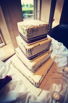 Jewels and sparkle on this wedding cake!   Photo by Danielle. #weddingcakesminnesota #weddingcake