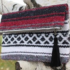 You can upcycle an old thrift store blanket into a beautiful clutch in under an hour. This project is a perfect DIY holiday gift that is both affordable and practical. Your friends and family will appreciate the fact that you spent the time to make them a unique, earth-friendly gift this season. Even beginning sewists will be able to create this...