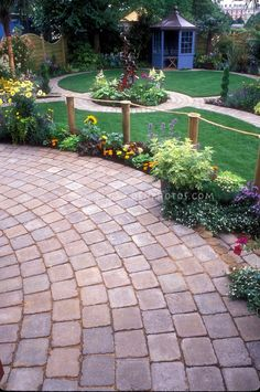 LOVE the brick paths to different areas in the ackyard. LOVE the wraparound path with a water fountin in middle.