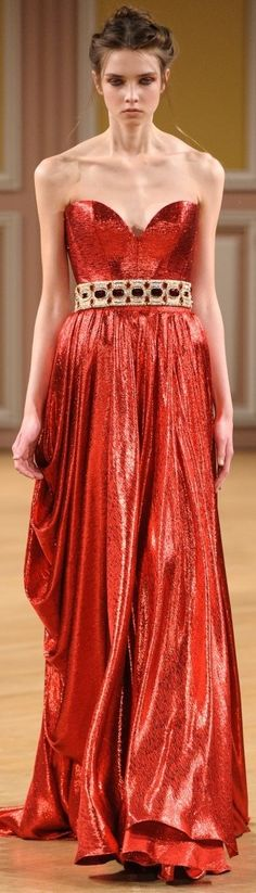 Tony Yaacoub 2013/2014.  The model looks like death, but I LOVE the dress.  It would look great on someone with a healthy body.