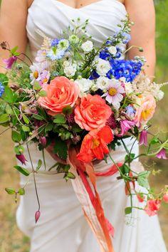 Bright bridal bouquet:  Taylor'd Events » A Lovely Wedding At Sleeping Lady Mt. Resort | Florist: McKenzie Powell Floral & Event Design; Photography: Amelia Soper Photography #Washingtonwedding #mountainwedding #leavenworth #wildflowers