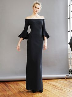 7f2be4eae03e Off the shoulder gown with bell sleeves that flare just before the elbow.  Fitted body and skirt falls straight from the hips. Hidden zipper in back.