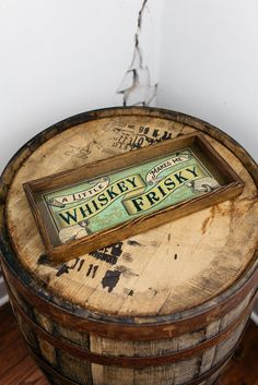 """This sassy """"A Little Whiskey Makes Me Frisky"""" serving tray makes a great gift for the person who enjoys a home bar and all its decor. It can be used as a unique serving tray or makes a classy bar sign"""