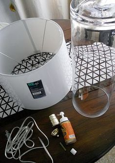 DIY lamp: I like the shape of the glass vase of the Crate & Barrel lamps shown in this post